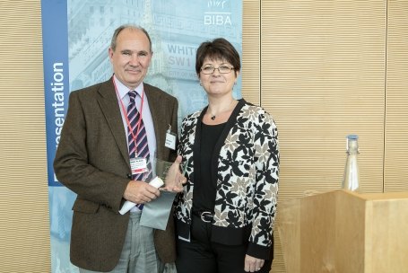 Receiving the award from one of the judges, Julie Page, CEO of Marsh's consumer & commercial practice.